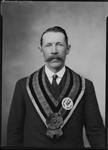 Studio portrait of Mr Hodgkinson wearing Scottish regalia of the Kalgoorlie Caledonian Society