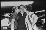 A kiss from Linda McGill (left) and Ruth Everuss is Australian Alex Alexander's reward (plus a gold medal) for his 110yds medley win
