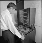 345984PD: Martin Clarke using a reel to reel player, 1968.