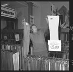 359440PD: John K. Watts in menswear store, 1972