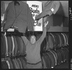359441PD: John K. Watts in menswear store, 1972