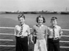 005081D: Two boys and a girl at the ships rail, 1950